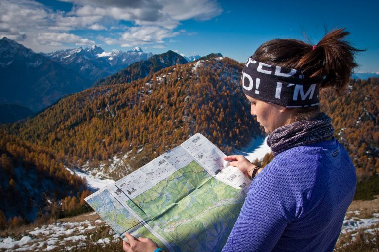 Hiker reading a map during a self-guided walking trip in Slovenia