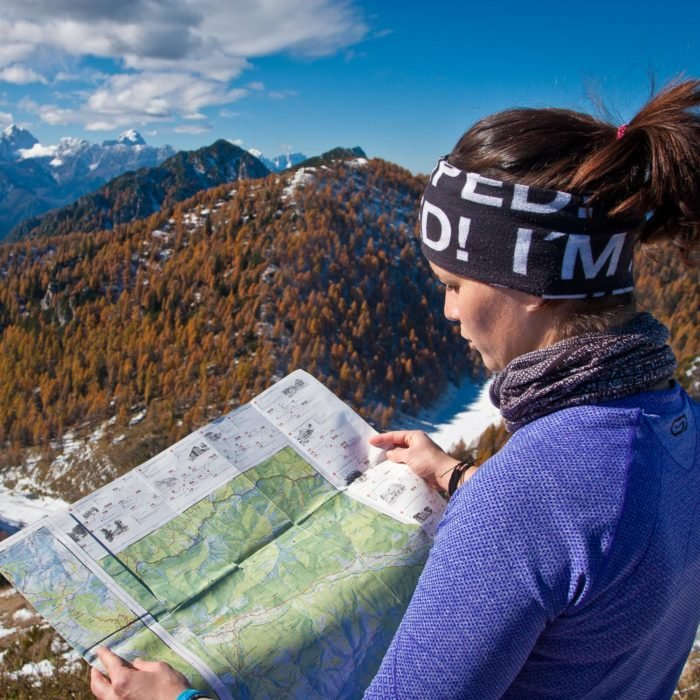 Hiker reading a map during a hiking trip in Slovenia