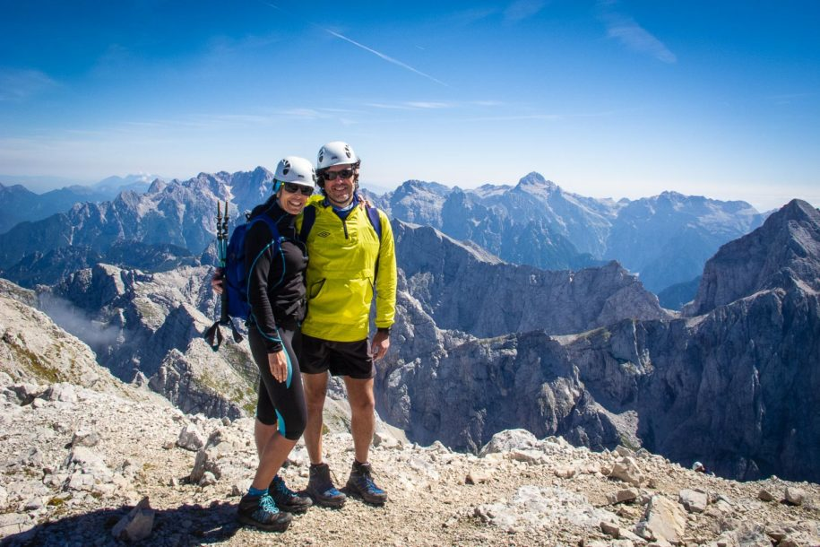 Hikers on top of Mt. Mangart on a hiking trip in Slovenia