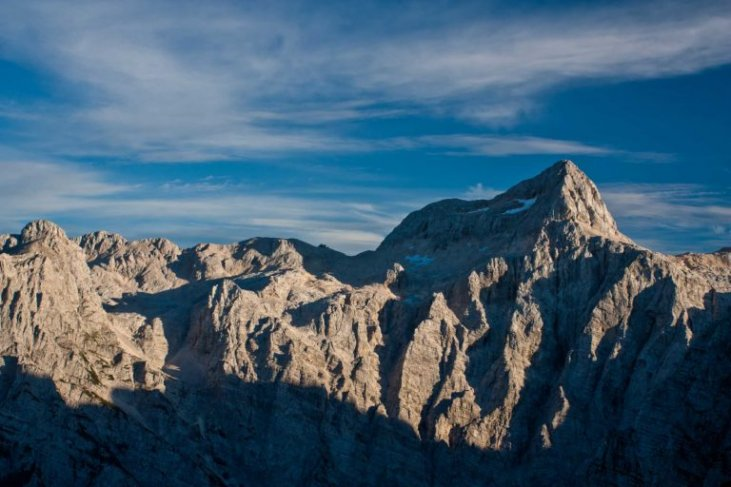 Mount Triglav with the Triglav North Face at summer sunset.