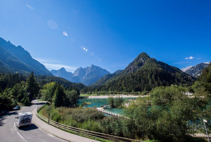 Travellers on adventure holidays in Slovenia explore the Julian Alps with lake Jasna by car.