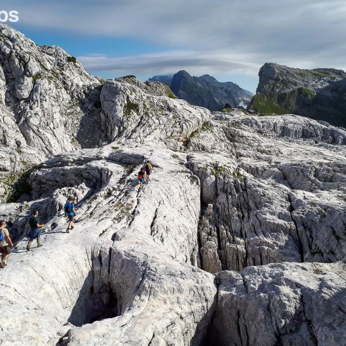 Walking across the karstic terrain of the Triglav National Park, Slovenia