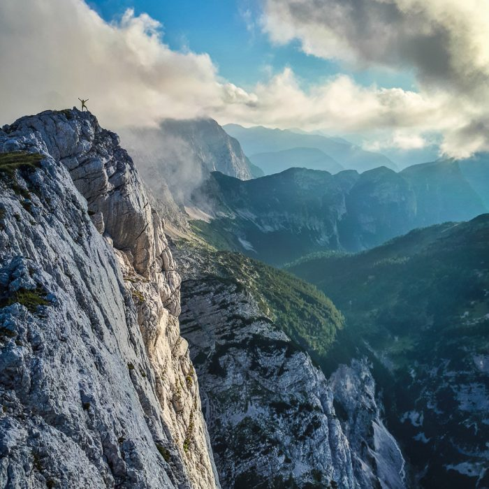 Hiking on the edge of a cliff in the Julian Alps, Slovenia
